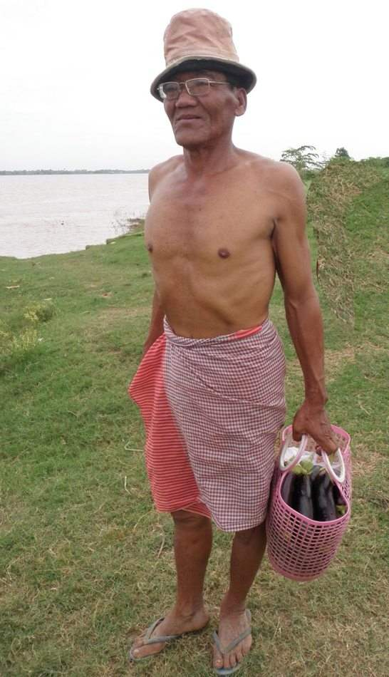 Man-In-Sarong-&-Funny-Hat-Cylcing-CambodiaMekong-Islands-102